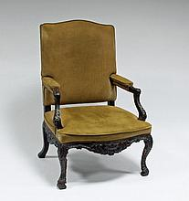A Louis XV walnut armchair with carved arms and