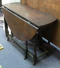 A late 17th Century oak gateleg table on turned