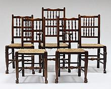 A set of nine spindle back dining chairs with rush