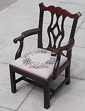 A child's mahogany armchair of Chippendale design,