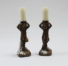 A pair of plaster candlesticks in the form of
