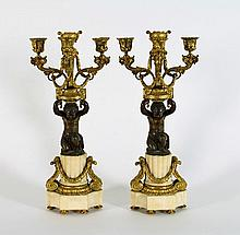 A pair of marble and ormolu mounted Empire table