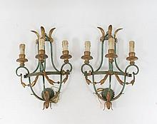 A pair of green and gilt painted three-branch wall