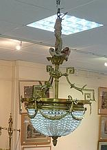 A gilt metal chandelier, with Greek key supports