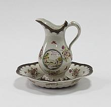 A transfer and hand coloured jug and basin, in the