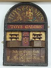 A carved and painted toy shop sign, 94cm (37'')