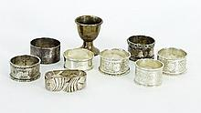 Eight silver napkin rings, circa 1910 and a silver