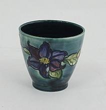 A Moorcroft Clematis pattern planter, on a pale