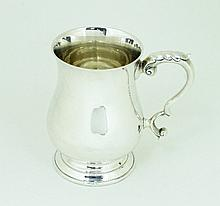 A silver half-pint baluster mug, London 1939, with