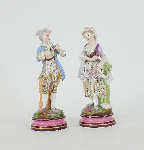 A pair of Continental porcelain figures, a young