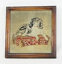 A Victorian needlework picture of a dog, 43cm x