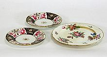 A pair of rose painted plates, 17.75cm (7'')