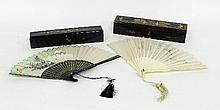 A boxed Chinese fan with carved ivory sticks and
