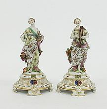 A pair of Continental figures of maidens, one