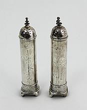 A pair of Tiffany and Co. sterling silver pepper