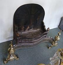 A George III style brass and iron serpentine fire