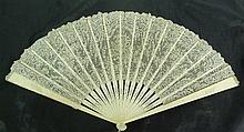 A French lace fan of flowers and foliage with
