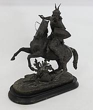 A spelter model of a Gaul on horseback, a sword in