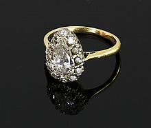 A pear-shaped diamond cluster ring, the principal