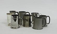 A pewter tankard, the glass base containing three