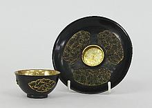 A Chinese parcel gilt and niello cup and saucer