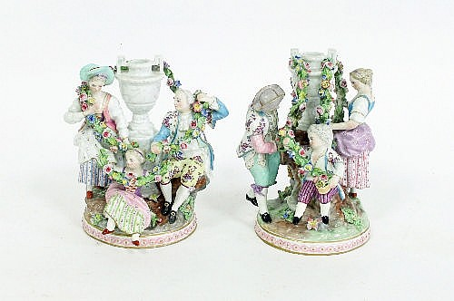 A pair of German porcelain figure groups, late
