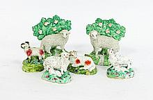 Six English porcelain and pottery models of sheep,