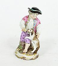 A Meissen model of a boy with dog, late 19th