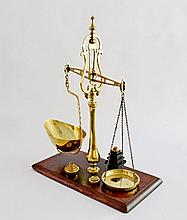 A Victorian set of brass scales, with pierced beam