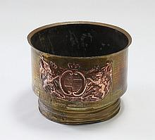 A brass and copper log bin, chased with armorials,