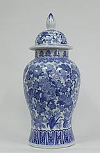 A large Chinese style blue and white jar and