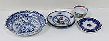A blue and white saucer dish decorated an exotic