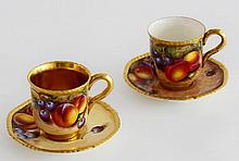 Two Royal Worcester fruit-painted coffee cups and