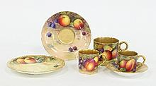 A group of Royal Worcester fruit-painted items,