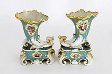 A pair of porcelain turquoise ground cornucopia