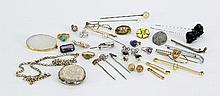 An engraved silver locket, a brooch, stick pin etc