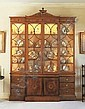 A GEORGE III SATINWOOD AND FLORAL MARQUETRY BREAKFRONT BOOKCASE