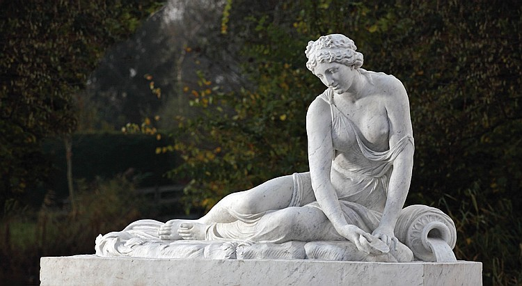 A carved white marble figure of 'Nymphe a la Coquille'