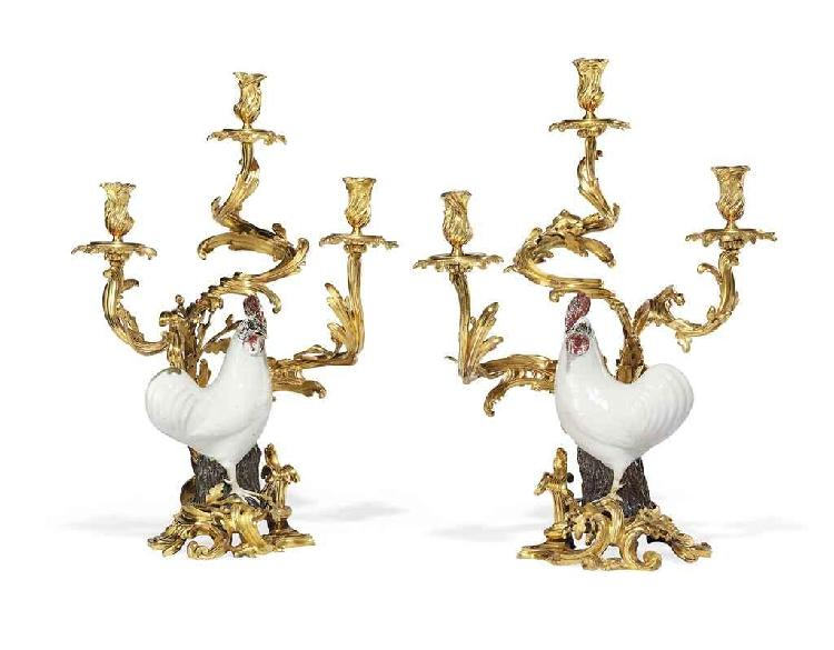 A PAIR OF LOUIS XV ORMOLU AND CHINESE PORCELAIN THREE-LIGHT CANDELABRA