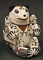 Acoma pottery storyteller figure