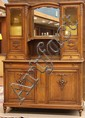 Carved French buffet, last quarter 19th century, the mirrored superstructure with double vitrines having bevelled glass doors conjoi...