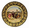 Royal Vienna hand painted scenic plate, having a raised gilt border surrounding the scenic central reserve depicting a court scene w...