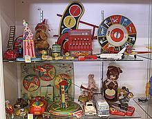 (lot of approximately 30) Two shelves of tin lithograph toys, including a Honeymoon Express by Marx having two planes, a mechanical...
