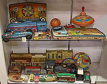 (lot of approximately 25) Two shelves of tin lithograph toys, including a Roy Rodgers Mineral City western town by Marx, a wind-up s...