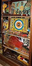 Four shelves of associated military, western, and target shooting toys, including three tin lithograph targets, a battery operated J...
