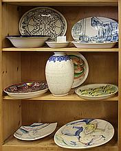 (lot of 11) Studio art pottery group, including (3) fish platters by Delia Schalansky; (3) sgraffito decorated serving pieces by Joh...