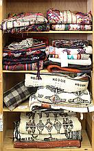 (lot of approx 21) Four shelves of ethnographic textiles, including Tibetan cotton embroideries, Fulani Wedding blankets from Mali, ...