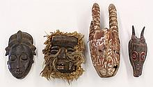 (lot of 4) West African masks, consisting of Guere style mask from the Dan Complex, Liberia decorated with raffia; Baule style, Ivor...