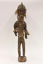 West African style carved wood standing male figure, 36