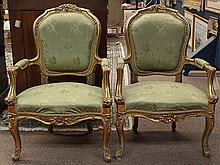 Pair of Louis XV style giltwood carved fauteuils
